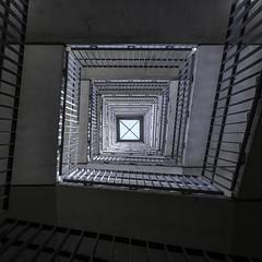 Vertigo (Job I) Tags: stairs symmetry interior concrete gray spiral light fugue geometry lines convergence