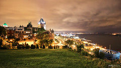 Québec City View (Québec, Canada) (Andrea Moscato) Tags: andreamoscato canada america view vista vivid overlook night notte notturno dark darkness light shadow ombre luci prato grass green sky cielo clouds city città cityscape nuvole yellow building water acqua river fiume