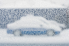 Blue Car, Snow (DaveLawler) Tags: snow drops water blue car lot parking worcester masnow abstract rain