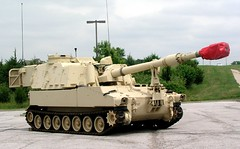 M109 155MM self propelled Howitzer (felixtcat) Tags: trees red green beige parkinglot gun military wheels artillery antenna paladin militaryvehicle m109a6paladin m109a6paladin155mmselfpropelledartillery 155mmselfpropelledartillery selfpreparedartillery 155artillerypaladintank m109155mmselfpropelledhowitzer