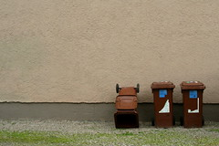 backyard threesome (anyone_anywhere) Tags: city brown strange wall trash germany grey three funny surreal minimal trashcan dustbin memmingen urbyn
