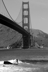 Small Wave Big Bridge (cwgoodroe) Tags: sf sanfrancisco bridge bw water golden gate surf surfer landmark surfing shore goldengate longboard unusual sfchronicle 96hrs sfchronicle96hours sfchronicle96hrs