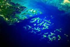 the hundred islands (Farl) Tags: ocean travel blue sea tourism colors coral islands philippines aerial hundred southchinasea luzon pangasinan hundredislands islets jul2006phg