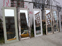 NYC #69 (digital_freak) Tags: nyc streetart eastvillage newyork reflection yellow fence mirror junk manhattan cab taxi bowery houstonstreet fleamarket digitalfreak