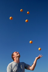 Grab those balls! (Fintan) Tags: blue sky man motion smiling festival speed bristol geotagged fun happy colorful bright circus space clown performance balls event oranges colourful juggling juggle juggler shape polarizer ashtoncourt polariser thebigdipper geolon2653542 geolat51446518