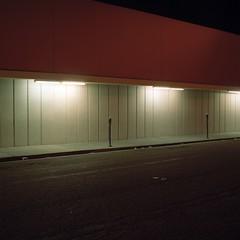 DK12 (peterbaker) Tags: street light red wall night sidewalk meter