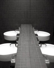 Figge Art Museum -- bathroom (Remiss63) Tags: blackandwhite bw copyright white reflection art museum architecture modern bathroom mirror blackwhite photographer sink modernism iowa double architect photograph davenport porcelain lavatory sinks allrightsreserved modernist figge chipperfield davenportiowa raimist lavatories andrewraimist davidchipperfield remiss63 july2006 figgeartmuseum