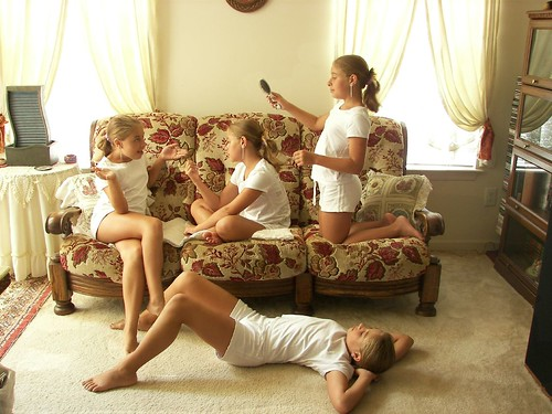 Multiplicity photograph of a girl in white clothing on a couch