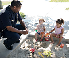 "then the toddler got a ""talking to."" (sesame ellis) Tags: park playing girl sand toddler mykid police cop year2 officer"