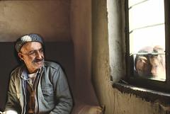 Glance through the window (Chris Kutschera) Tags: man window child iran middleeast curiosity glance kurdistan ziwa