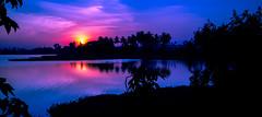 Shot at Varthur, Bangalore, India (pinku_aqua) Tags: blue sunset lake reflection colors silhouette bangalore karnataka abigfave