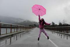 mi Valito (evephg) Tags: umbrella lluvia jumping south raining paraguas