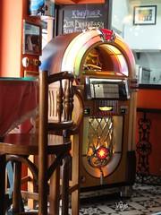 Juke box at SodaBottleOpenerWala (Vidya...) Tags: old music food brown beautiful fashion golden wooden high cafe chairs box small colourful quaint rare songs chai parsee irani juke parsi