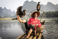 Cormorant dance 037A9756 (lycheng99) Tags: china travel red portrait people mountains feet nature smile face birds reflections river beard landscape liriver dance fisherman dancing guilin yangshuo bamboo cormorant raft mustache guangxi bambooraft xingping chinatravel líjiāng 興坪