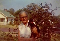 George's Sister (Midnight Believer) Tags: oklahoma dog neighborhood oldlady lostphoto retro elderly pet outdoors 1960s