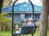 A Quiet Swing (soniaadammurray - Off) Tags: digitalphotography bench benchmonday people man woman swing park marinajackpark couple