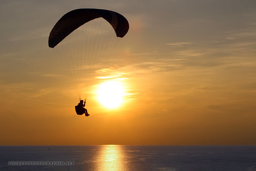 high in the sky. Parachutist on a view point Ya Nui