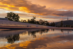 且待晴时 wait till the storm is gone (nzfisher) Tags: sunset sundown twilight dusk stormy storm sky clouds cloudy golden orange reflection parliament canberra australia act capital 50mm canon