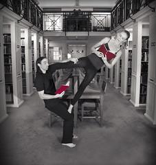 Balancing with Books (Jim Carrington - CB1 Photography) Tags: spectacular dance cambridgeuniversity acrobalance library peterhouse performance books