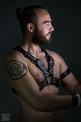 Basti 04 (WF portraits) Tags: portrait hairy man male leather studio naked nude beard model chest tunnel piercing tattoos ear harness aut