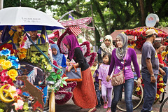 Malaysian women climbing in rickshaws, Malacca, Malaysia (Alex_Saurel) Tags: travel portrait people color tree asian asia day veiled veil action outdoor tricycle muslim islam group scenic hijab photojournalism streetscene portraiture malaysia asie fullframe arbre voile islamic 50mmf14 reportage malaisie  malasia portray fullbody  photoreport photoreportage lifescene 35mmprint planitalien pleinformat planpied malasia