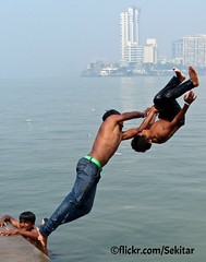 Double jump around Haji Ali Bukhara Mausoleum, Mumbai (Sekitar) Tags: boy shirtless india male guy water fun jump ali mausoleum mumbai bukhara haji earthasia