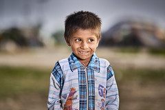 Mischief (KHK Images) Tags: boy lad young outdoor portrait daylight bokeh naughty mischievous funny smile happy gypsy nomads village life rights shelter homeless travel traveling