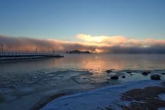 The sun is trying to peek through the seafog (KaarinaT) Tags: ice icey icefloes freezing freezingtemperatures freezingweather mist fog seafog helsinki finland kaivopuisto bluesky sunrise dawn morning winter january snow pier