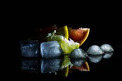 Citrus fruits (yedmitry) Tags: citrus fruits dark ice food lemon lime orange grapefruit reflection