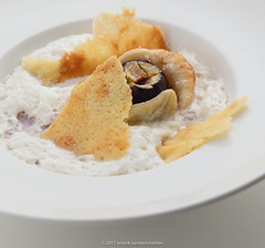 Tarte tatin of fig with espuma of cantal cheese. (annick vanderschelden) Tags: baked baking bakingpaper butter cooking crisp crusty dessert espuma figs foam hand humanhand incision oven pack pointofview preparation pressure puffpastry redwine seeds step stick sugar syrup tartetatin three two whitekitchenboard whiteplate belgium