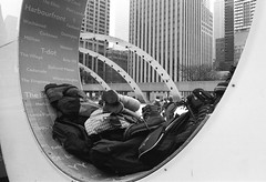 T-Dot (Georgie_grrl) Tags: nathanphillipssquare skating icerink winter skaters cold fun friends family pentaxk1000 rikenon12828mm jchstreetpan400 blackandwhite monochrome toronto ontario tdot sign boots jackets