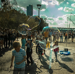 Fun in the town (A Pourshariati) Tags: uk england people urban sunlight playing london kids clouds fun daylight bubbles pentaxkr pentaxzoom summer2015