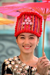 Pink umbrella and  Chinese girl from Dehong, Yunnan (adamba100) Tags: life china street city trip travel light boy portrait people woman man color colour cute male men tourism lamp girl beautiful beauty face female children landscape asian person star town canal costume kid interesting women asia pretty vietnamese cityscape child play dress view outdoor traditional innocent sightseeing chinese decoration beijing lifestyle style charm korea headshot tourist vietnam mongolia korean human thai innocence lantern gadget performer pure channel pendant purity garb mongolian attire