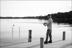 Fishing (Eline Lyng) Tags: leica sea people man nature water norway landscape 50mm coast fishing eveningsun coastline larkollen leicamonochrom aposummicron50mm