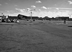 Shopping Center (Robert S. Photography) Tags: ceasarsbay bazzar shoppingcenter bw winter bestbuy modells pavement cars streetlamps sky clouds scene street bicycle brooklyn bayparkway nyc nikon coolpix l340 iso80 january 2017