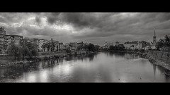 Dramatic clouds over Lugoj (Kimmo Räisänen) Tags: canoneosm tamron18200mm bw blackandwhite monochrome river lugoj romania cinemascope widescreen dramaticsky