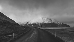 returning to the cold (lunaryuna) Tags: iceland northiceland northfjords landscape panorama coast fjord mountain textures water sky weather weathermood clouds lightmood spring season seasonalchange boggrass thecolioursoficeland nature beauty solitude stillness lunaryuna road ontheroadagain journey travel voyage blackwhite bw monochrome
