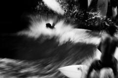 . (www.piotrowskipawel.pl) Tags: photojournalism journalism reportage documentary documentaryphotography sport action hobby riversurfing surfer surfing eisbachriver eisbach water waves wave bw blackwhite blackandwhite monochrome munich bayern wellenreiter
