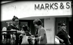 Competitors (* RICHARD M (Over 6 million views)) Tags: street candid mono blackwhite streettrader streetvendor entrepreneur shopper shopping marksspencer garments cutprice thecompetition lowcost bargains bargainbuy customer smiles happy happiness cityofbath somerset bath