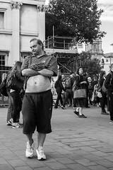 Making a statement (shotbywiles) Tags: street man west guy london fuji trafalgarsquare tourist end fujifilm cobbles westend wiles streetphotographer fujix xpro1 xf18mm wilesphotographycom wilesstreetphotographer wilesstreetphotography
