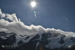 Grossglockner (lg-photographic) Tags: summer sky sun white mountains nature weather clouds lens landscape austria österreich nikon outdoor sommer natur himmel wolken berge lensflare flare rays landschaft sonne epic sonnenstrahlen wetter grossglockner weis d3200 drausen grosglockner episch