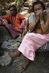 Sadhus smoking a pipe along the Annapurna trail in Nepal