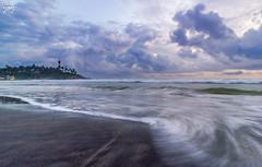 Take Me To The Light (Yogendra174) Tags: sunset sea lighthouse india beach clouds waves kerala monsoon kovalam scurve seaface leadinglines sunsetonbeach postmonsoon 1018mm