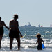 A family enjoys Gator Beach as an Arleigh Burke-class guided-missile destroyer is underway off the coast of Southern California.