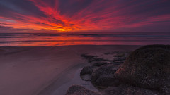 Sunrise on the rocks (adamcaird) Tags: sun sunrise seaside sea sky water reflection red orange colourful canon colour warm landscape seascape waves scotland outdoor outdoors clouds canon6d canon16mm35mm cokin filter graduated sand nature winter ngc