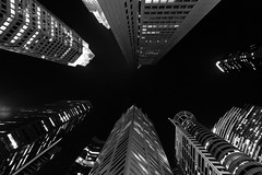 Looking up the city (Hendraxu) Tags: black white blackwhite blacknwhite blackandwhite monochrome mute dark sky tower building architectural architecture skyscrapers skyscraper tall