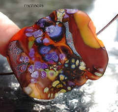 Raphaella (Laura Blanck Openstudio) Tags: openstudio openstudiobeads jewelry fine arts art handmade lampwork glass beads single focal bead artist whimsical funky odd necklace pendant abstract asymmetric colorful multicolor flat wearable nugget rock stone pebble lucky charm matte glow frosted etched opaque frit big holes murano winner published show festival huge organic earthy violet plum eggplant purple lilac lavender raku rose ocher orange coral amber burnt umber copper green