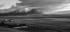 as far as the eyes can see (lunaryuna) Tags: iceland northwesticeland vatnsdalur vatnsdalsfjall panoramicviews mountainrange hills agriculture farms formerriftvalley sunset sundown thelightfantastic nature landscape beauty lunaryuna sky clouds blkackwhite bw monochrome