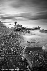The Waiting Game (David Relph) Tags: longexposure sea portrait blackandwhite bw seascape beach canon mono coast rocks yorkshire wideangle northyorkshire longshutterspeed weldingglass reighton tamron1024mm davidrelph davidrelphphotography