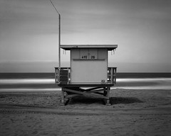 ave 26. venice beach, ca. 2015. (eyetwist) Tags: eyetwistkevinballuff eyetwist ave26 lifeguard venicebeach longexposure fotoman 45ps 150mm ilford copy plus ortho orthochromatic sheet 4x5 dr5 bw blackwhite black white mono reversal transparency slide film fotoman45ps fujinonw150mmf56 ilfordcopyplus dr5bwreversal dr5filmlab ocean beach pacificocean venice la pacific baywatch 26thavenue westla losangeles los angeles angeleno socal california largeformat ishootfilm ishootilford analog analogue sheetfilm epsonv750pro long exposure 1000x neutraldensity 10stop nd 110 nd110 neutral density filter tower hut stand sand horizon waves blur seascape dr5chrome chrome